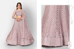 Mauve color Soft Net Fabric Heavily Embroidered Lehenga Choli