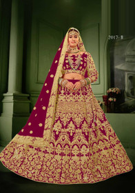 Magenta color Net Fabric Heavily Embroidered Lehenga Choli