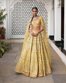 Yellow color Silk Fabric Lehenga Choli