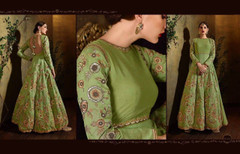 Green color Full Sleeves Floor Length Silk Fabric Anarkali style Suit