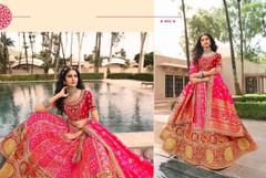 Magenta and Red color Banarasi Silk Fabric Lehenga Choli