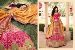 Magenta and Peach color Banarasi Silk Fabric Lehenga Choli