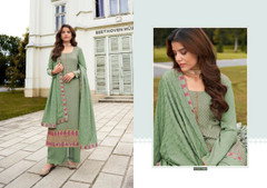 Green color Chinnon Fabric Suit