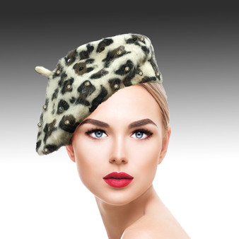 This luxurious leopard printed mohair beret features scattered cognac sequins.