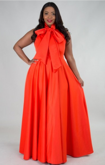 This spandex polyester blend dress is accented with a bow and available is sizes 1X, 2X and 3X.