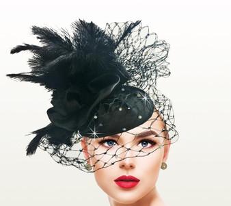 This juliet cap fascinator features a honeycomb veiling and ostrich bouquet.