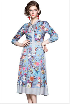 This floral print bowtie dress is 100% polyester and available in sizes medium, large, extra large and 1XL.