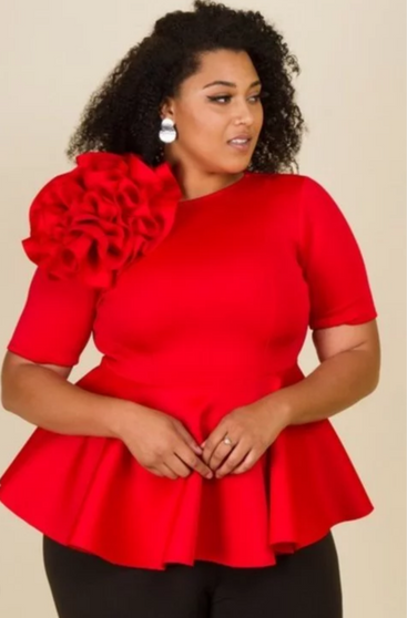 Rose flower top is available in red and black and in sizes XL, 2X and 3X.
