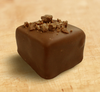 Milk chocolate truffle by Ü Chocolate for the World