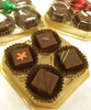 Close up  of the 4-piece Truffle Taster by Ü Chocolate for the World