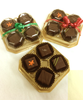 Three packs of the 4-piece Truffle Taster by Ü Chocolate for the World