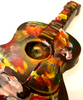 Close-up view of hand-painted acoustic guitars by Ü Chocolate for the World