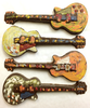 Four variations of the hand-painted electric guitar by Ü Chocolate for the World