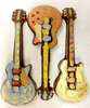 Three variations of the hand-painted electric guitar by Ü Chocolate for the World