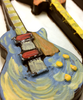 Detail view 4 of of the hand-painted electric guitar by Ü Chocolate for the World