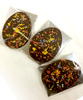 Three packages of the Flat Easter Egg by Ü Chocolate for the World