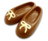 Milk chocolate ballet slippers with white accents.