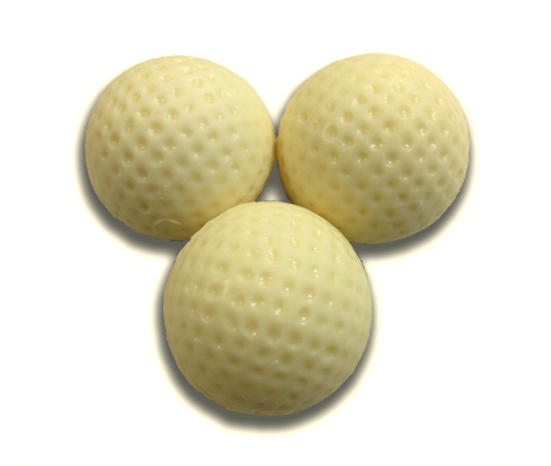 Set of three white chocolate golf balls.