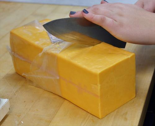 Hand cut Sharp Cheddar Cheese