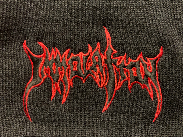 BEANIE CAP:  Embroidered Black Logo w/RED Outline