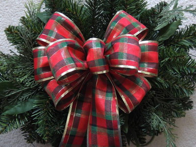 Holiday bows are a nice addition to any Christmas wreath for your door.