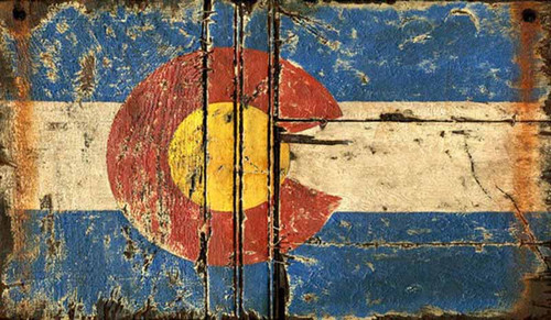 Colorado State Flag, Red Horse sign, on distressed knotty wood panel. Colors red, blue, white and yellow.