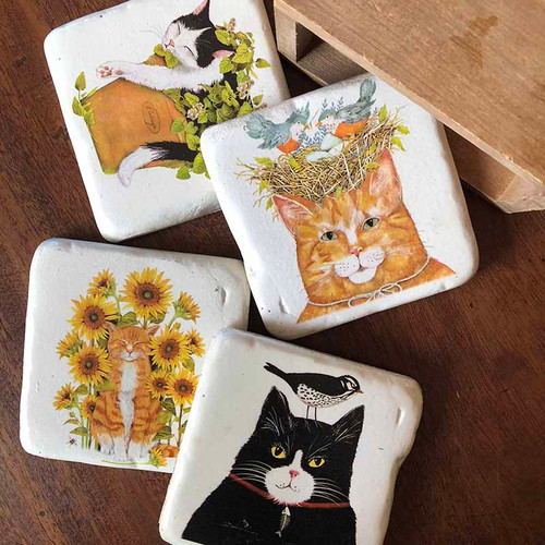 Cat Coasters, Creative Coop, set of 4 and box, measures 3.75 inches square, made of hard resin and cork base.Black cat, black and white cat, two tabbies make up this hilarious collection, add a bird for some mischief.