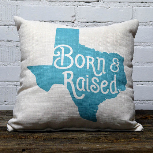 The Little Birdie, Born and Raised, throw pillow,  Born and raised in white letters on a light blue background outlined in the State of Texas