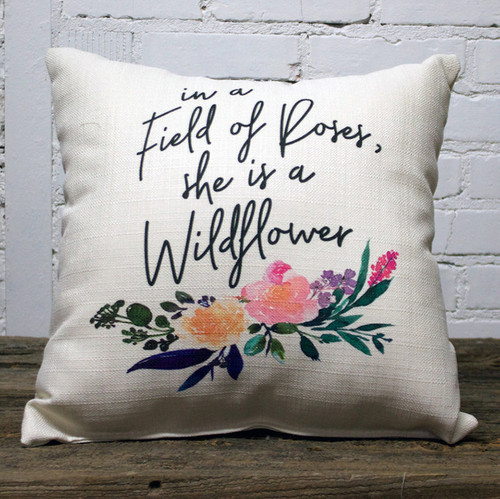 "The Little Birdie, She is a Wildflower Bouquet, throw pillow, 16 inches square. Full quote, ""In a field of roses, she is a wildflower."""