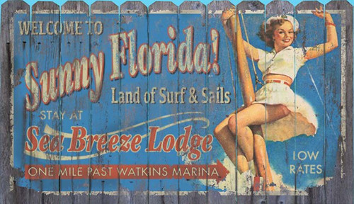 Sunny Florida, Red Horse Signs, Vintage art on distressed wood,  image of a vintage billboard featuring a sandy haired girl holding on to a mast while welcoming you to the land of surf and sail, stay at the Sea Breeze Lodge