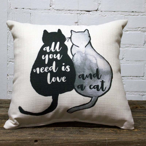 All you need is love and a cat throw pillow, The Little Birdie pillows, image of black cat and white cat cuddling