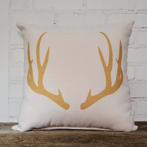 Gold Antler pillow, The Little Birdie, measures 16 inches square, image of a pair of golden antlers, white background
