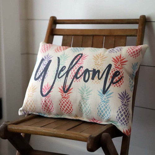 "Welcome Pineapple rectangular pillow, The Little Birdie, multi-colored pineapple background with the message ""welcome"""