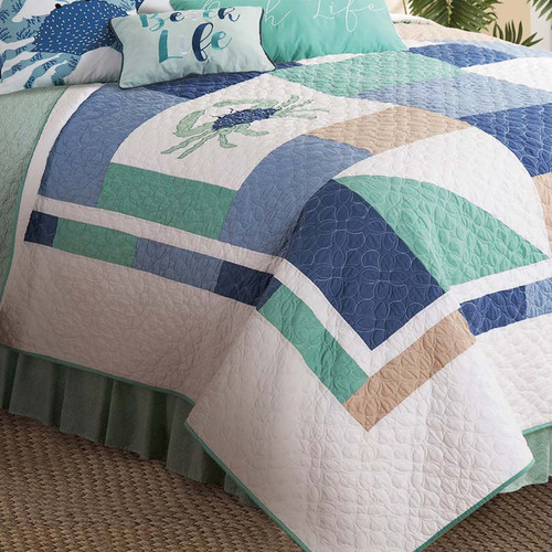 Macleay Island Queen Quilt, C & F Home, the colors are pastel blues, turquoise and white, beach-themed quilt with whimsical sea turtles, seahorses and starfish, surrounded by color blocks in sea green, blue and aqua on a white background, reverses to green