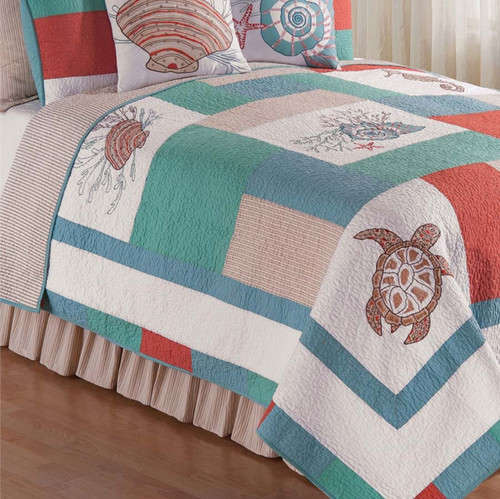 Folly Beach Queen Quilt, C & F Home, named for Folly Beach, South Carolina, with turtles and clams and sea horses and mollusks, in soft pastel colors of orange, green, blue, taupe, and white. Reverse stripes