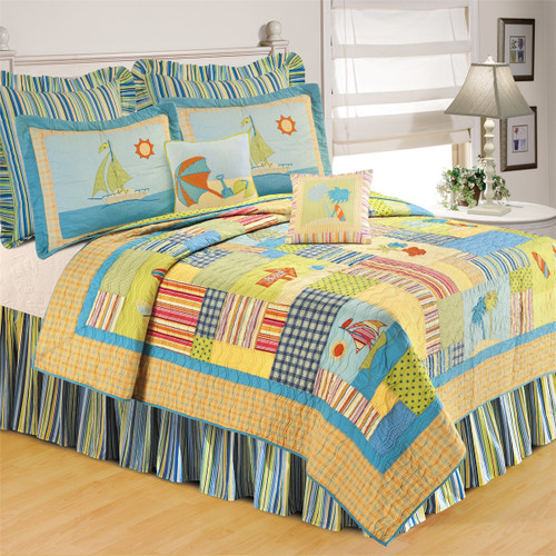 Beach Life Queen Quilt, C & F Home, bright yellow is the predominant color, but there are a rainbow of colors and fanciful scene of figures of sailboats and palm trees, water and surfboards. Panels include plaids and stripes and ditsies. Reverse yellow and blue ditsy