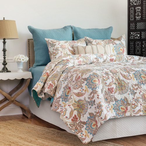 Lucianna Quilt, C and F Home, a multi-colored boho-chic inspired floral design in shades of teal, rust, red, yellow, gold, chocolate and sandstone on an antique white