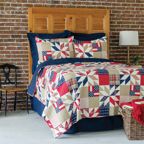 Levi Bedding Set, Quilt and 2 Shams, C and F Home, beautiful traditional star pattern in an American flag motif, multi-color, red, white, and blue, of course, along with taupe, squares include solids, plaids, and ditsy patterns, room view