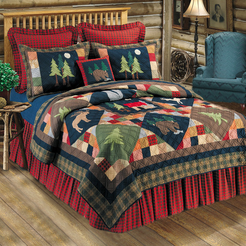 Timberline Queen Quilt, C and F Home, a background of small multi-pattern blocks, larger diamond shaped solid blocks with a moose, cabin, bear and tree