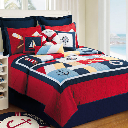 Sail Away Queen Quilt, C and F Home, a bold statement of blues, red, yellow, and white, a nautical theme that includes a light house, anchor paddles and boat.