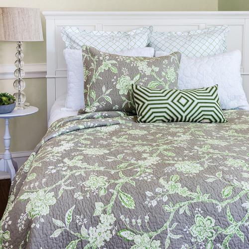 Annabelle Queen Quilt, C and F Home, soft subtle watercolor style brushstrokes of pale green florals and cross-hatched vines on white against a cool, turtle dove gray background