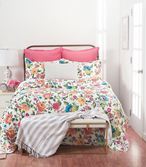 Summer Quilt Set, Queen Quilt and 2 Shams, C and F Home, colorful flowers everywhere, pink, red, yellow, blue, a perpetual summer of blossoms, room view on iron bed