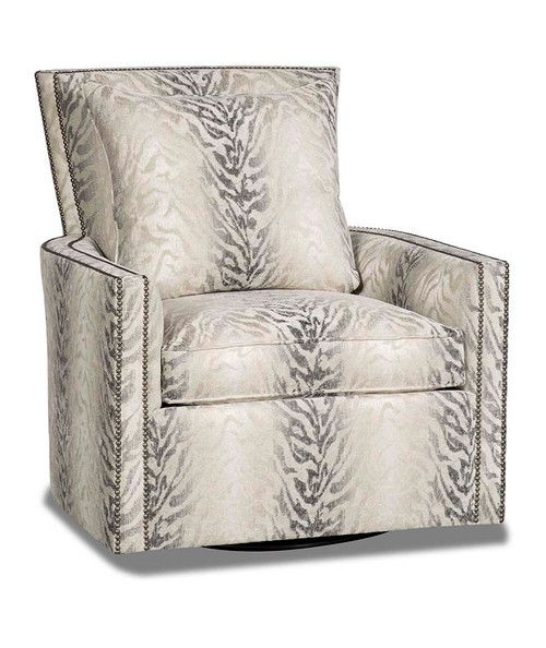 The gently arched back, loose cushion, block arms, and nail-head trim all contribute to the contemporary look and comfortable feel of the Clarice Swivel Chair by Paul Roberts