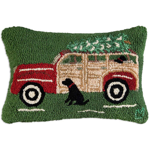 Chandler 4 Corners, Red Woody Wagon Hooked Wool Pillow - a couple of Black Lab dogs, a classic wood panel car with and a tree on top captures the fun holiday tradition of bringing home the Christmas tree.