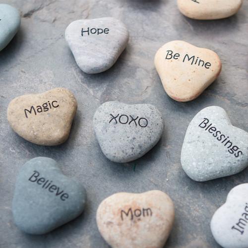 "Beach Pebble heart shaped, engraved with ""hugs""."