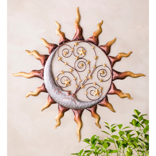 Handcrafted metal sun, stars and blowing moon wall art.