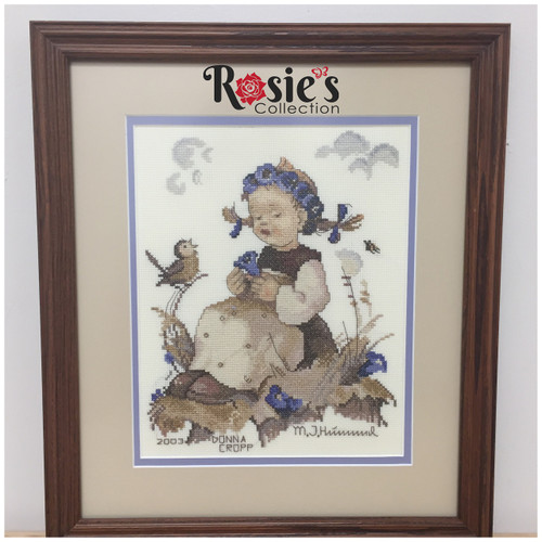 Cross Stitch by Donna Cropp - Girl with Blue flowers and a bird