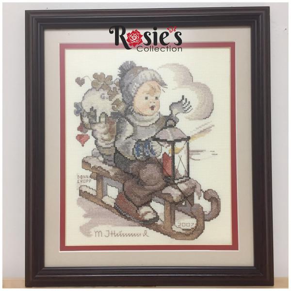 Cross Stitch by Donna Cropp - Boy on a sled