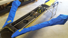 Wing Covers can save your carbon riggers from sun exposure.  They will Velcro right into your boat cover.