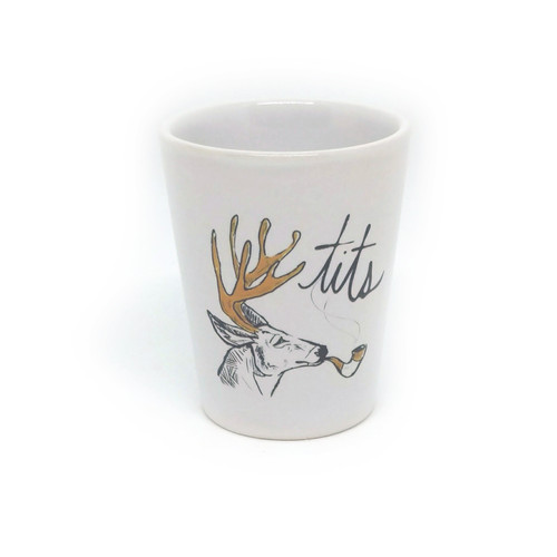 This shot glass holds two ounces, so watch out! You may be cursin' like a noble deer faster than you realize.